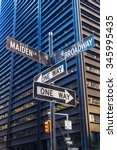 street name signs at Broadway and Maiden Lane in Manhattan, NYC