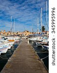 Small photo of Aegina, Greece - November 23, 2015: Fishing boats and sail boats in the port of Aegina, Greece