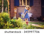 Child Girl Watering Flowers In...