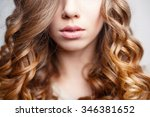 beautiful pink lips close up.... | Shutterstock . vector #346381652