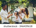 parents with baby enjoying... | Shutterstock . vector #346439618