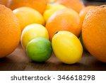 lime  lemon  orange on wooden... | Shutterstock . vector #346618298