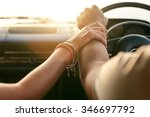 Stock photo close up shot of loving couple traveling by car and holding hands focus on hands of man and woman 346697792