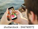 hands of a man holding a online ... | Shutterstock . vector #346760072