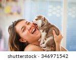 Stock photo happy women playing puppy dog 346971542