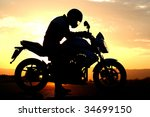 motorcyclist silhouette at the... | Shutterstock . vector #34699150