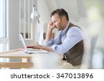 man working on laptop computer | Shutterstock . vector #347013896