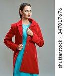 fashion model in red coat... | Shutterstock . vector #347017676
