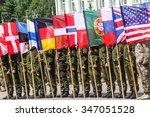 RUKLA, LITHUANIA - JUNE 8, 2015: Soldiers formation with NATO flags - stock photo