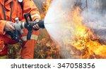 firefighters battle a wildfire | Shutterstock . vector #347058356