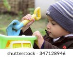 boy 2 years old playing with a...   Shutterstock . vector #347128946