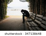 depressed young man sitting on... | Shutterstock . vector #347138648