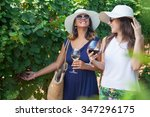 smiling women drinking wine and ... | Shutterstock . vector #347296175