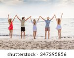 summer beach at sunset. a group ... | Shutterstock . vector #347395856