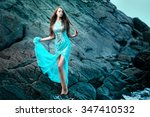 fashionable woman posing on a... | Shutterstock . vector #347410532