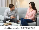 happy couple on sofa  on home... | Shutterstock . vector #347459762