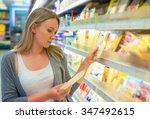 Woman Choosing Cheese In...