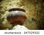 a clay jug standing on a sand... | Shutterstock . vector #347529332
