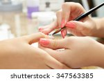nails painting with brush in... | Shutterstock . vector #347563385