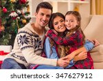 young happy family while... | Shutterstock . vector #347627912