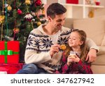 young happy family while... | Shutterstock . vector #347627942