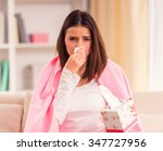 Small photo of Disease. Young beautiful woman during treatment at home