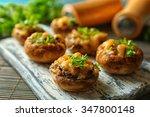 stuffed mushrooms on wooden... | Shutterstock . vector #347800148