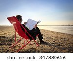 Businessman Reading The News A...
