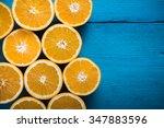 fresh half cut oranges on... | Shutterstock . vector #347883596