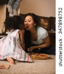 mother and daughter eating... | Shutterstock . vector #347898752