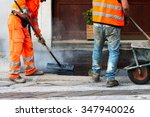 workers asphalting the street | Shutterstock . vector #347940026