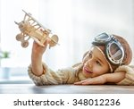 happy child girl playing with... | Shutterstock . vector #348012236
