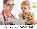 doctor examining a child girl... | Shutterstock . vector #348012242