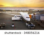loading cargo on the plane in... | Shutterstock . vector #348056216