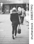 a blonde girl is walking in the ... | Shutterstock . vector #348057992