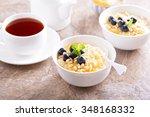 cooked millet porridge with... | Shutterstock . vector #348168332