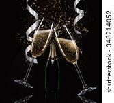 glasses of champagne with splash | Shutterstock . vector #348214052