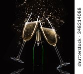 glasses of champagne with splash | Shutterstock . vector #348214088