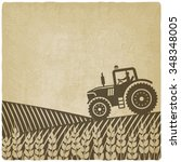 tractor in field old background.... | Shutterstock .eps vector #348348005
