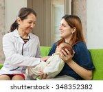 mature pediatrician doctor... | Shutterstock . vector #348352382