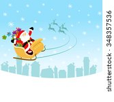 santa flying with sleigh   Shutterstock .eps vector #348357536