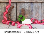 Stock photo lucky charm and ribbon on wood copy space 348373775
