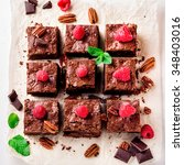 brownie pieces with nuts on... | Shutterstock . vector #348403016