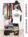 many clothes on the rack with a ... | Shutterstock . vector #348431615