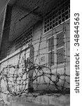 barbed wire fence around prison ... | Shutterstock . vector #34844563