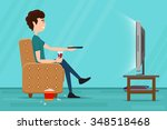 man watching television on... | Shutterstock . vector #348518468
