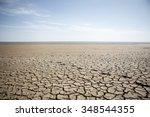 dry cracked earth. the desert.... | Shutterstock . vector #348544355