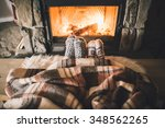 feet in woollen socks by the... | Shutterstock . vector #348562265
