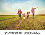 family running together in the... | Shutterstock . vector #348608222
