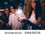 young friends out at night ...   Shutterstock . vector #348658538